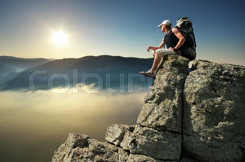 Stock image of 'Man on top of mountain. Conceptual and adventure scene.'