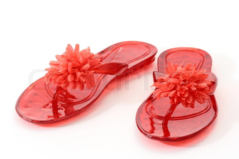 405ccd13b Close up of red plastic sandals over ...