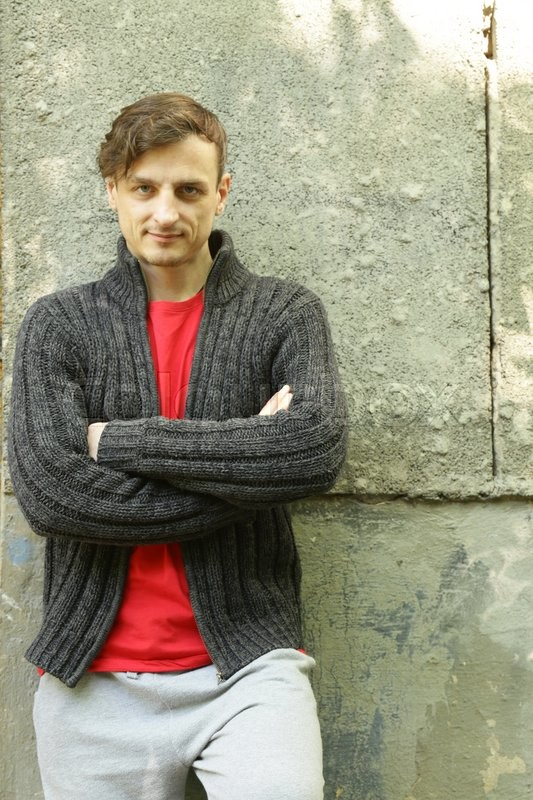 Stock image of 'Portrait of a young man in a warm knitted casual sweater'