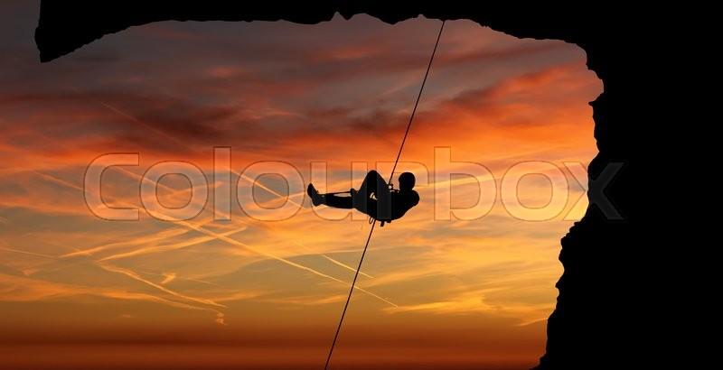 Stock image of 'Silhouette of Rock Climber at Sunset panoramic view'
