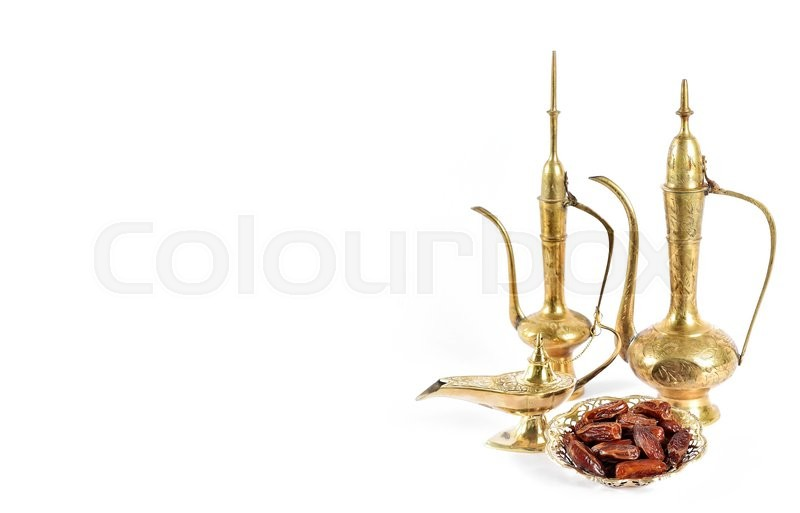 Stock image of 'Arabic traditional dishes, pots and dates fruits. Oriental holidays decoration'