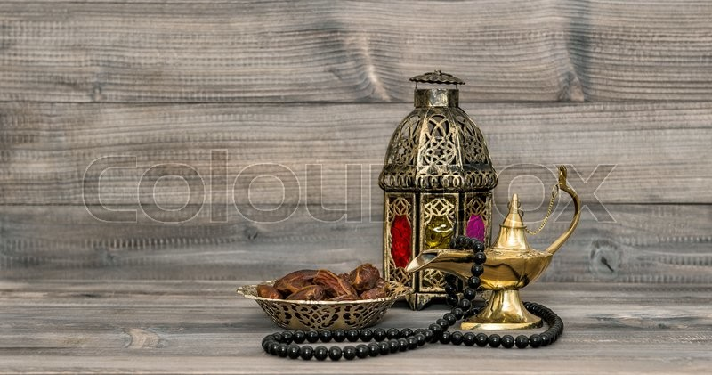 Stock image of 'Vintage arabic lantern islamic rosary beads. Oriental holidays decoration with dates fruits'