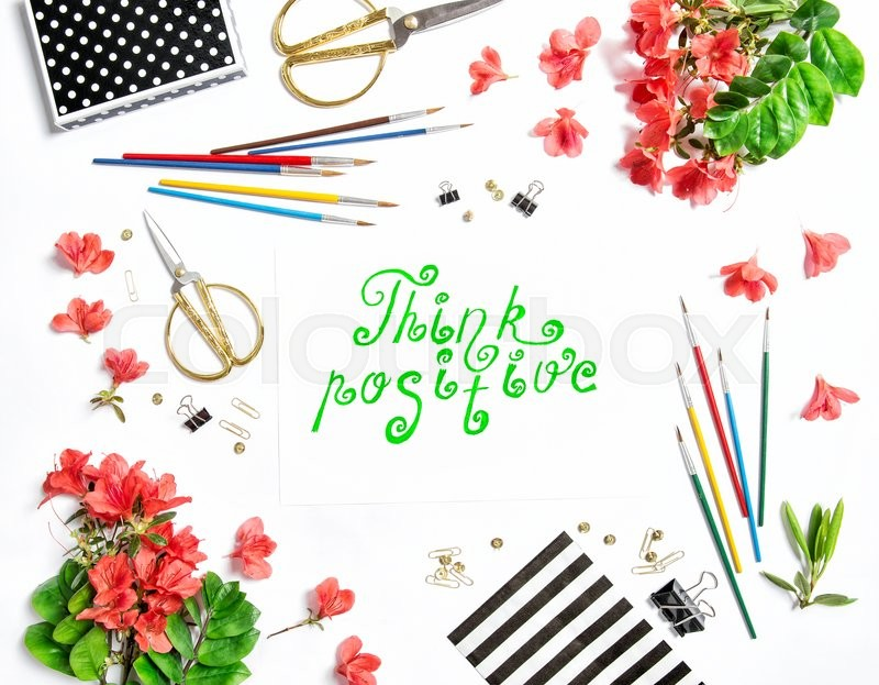 Stock image of 'Flat lay with sketchbook, flowers, office supplies on white background. Quote Think positive'