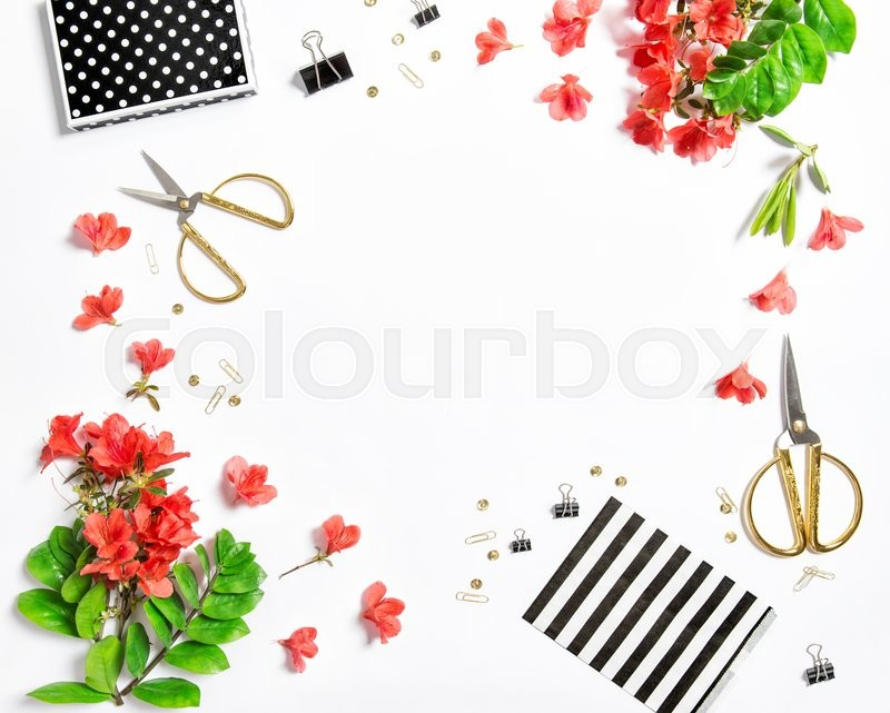Stock image of 'Artistic flat lay with sketchbook, flowers, office supplies on white background'