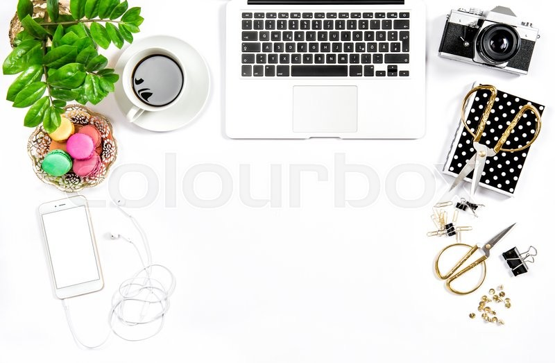 Stock image of 'Business still life. Feminine home office desk. Coffee and colorful macaroon cookies. Flat lay. Hero header for social media'