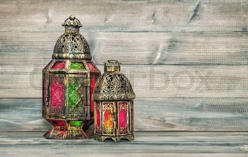 Stock image of 'Oriental light lantern. Arabic holidays decoration on wooden background. Vintage style toned picture'