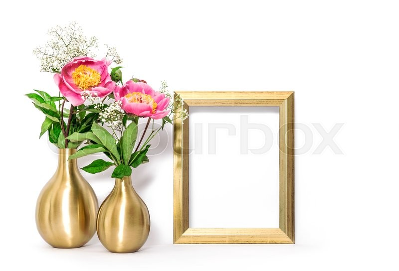 Stock image of 'Golden picture frame and pink flowers. Minimal style decoration with space for your image text work'