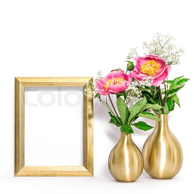 Stock image of 'Picture frame and pink peony flowers. Minimal style golden decoration with space for your image'