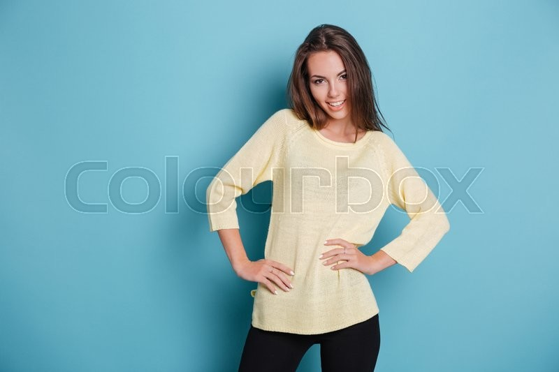 Stock image of 'Casual smiling woman looking at camera isolated on the blue background'