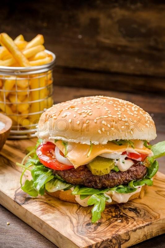 Burger Mit Pommes Auf Holz Untergrund Stock Photo Colourbox