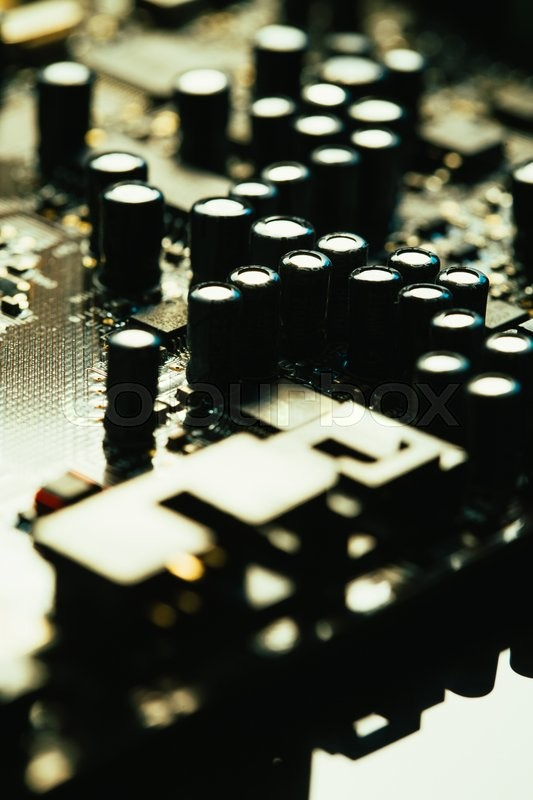 Stock image of 'Computer motherboard  closeup yellow gray color on dark background'