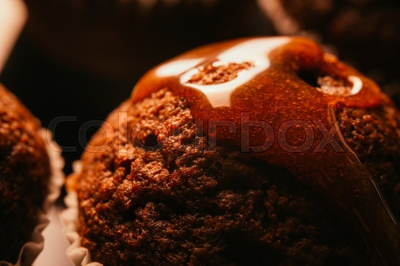 Stock image of 'Sweet homemade chocolate  muffin with caramel crumble on the top,selective focus'
