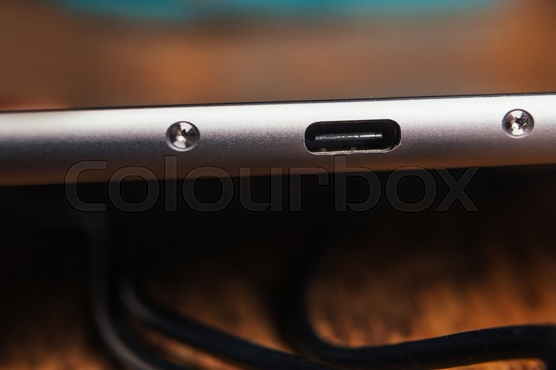 Stock image of 'new tablet with built-in usb-c  on wooden  background'