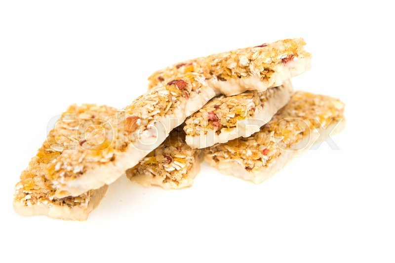 Stock image of 'muesli bars with  dried fruit on isolated  background'