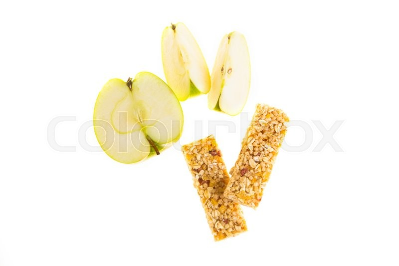 Stock image of 'muesli bars with dried fruit on isolated background with  apple'