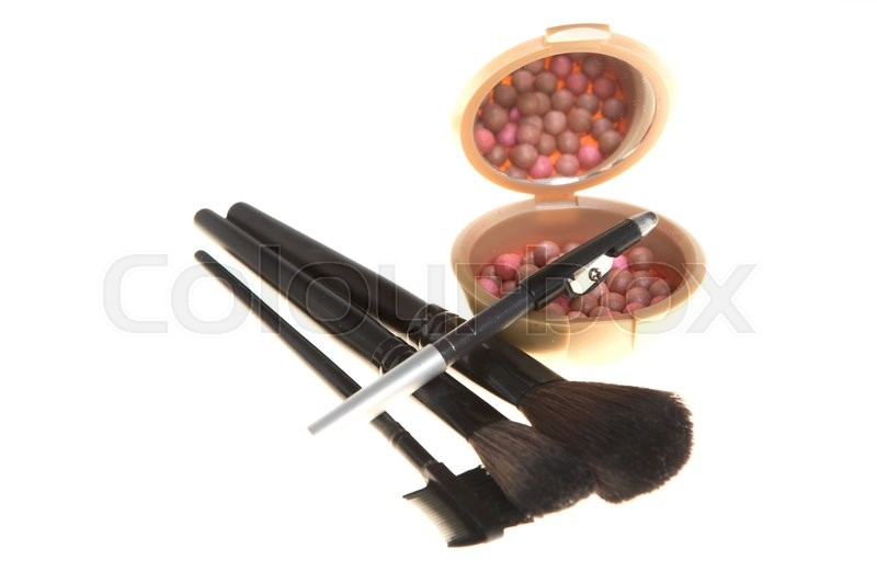Stock image of 'Blush in the balls and make-up brushes  close-up'