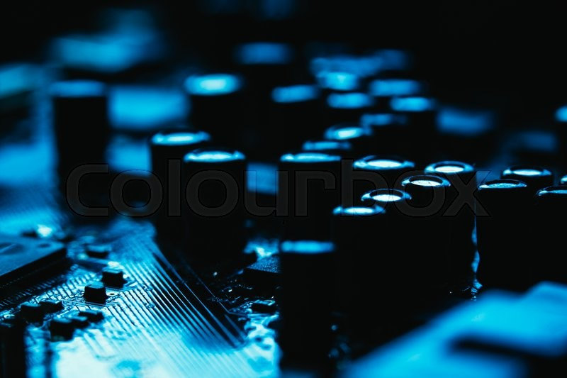 Stock image of 'Computer motherboard closeup  blue color on dark background'