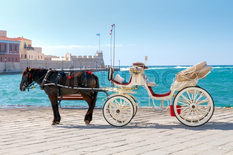 Stock image of 'The elegant horse-drawn carriage on the central promenade of Chania.'
