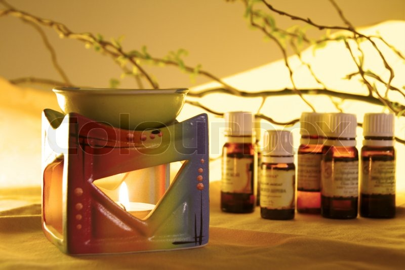 Stock image of 'Aroma Lamp with Burning Candle and Bottles with Oil Aromatherapy'