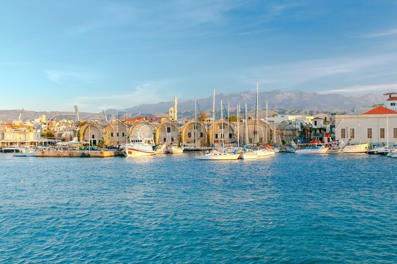 Stock image of 'Old warehouses on the waterfront of the Venetian harbor. Chania. Crete.'