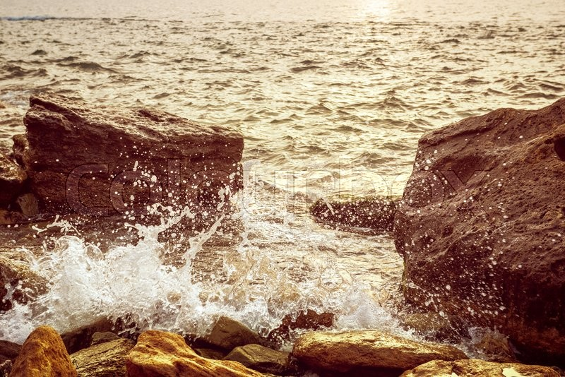 Stock image of 'Sea wave splashing on rocks, natural holiday sunny vintage hipster seasonal background'
