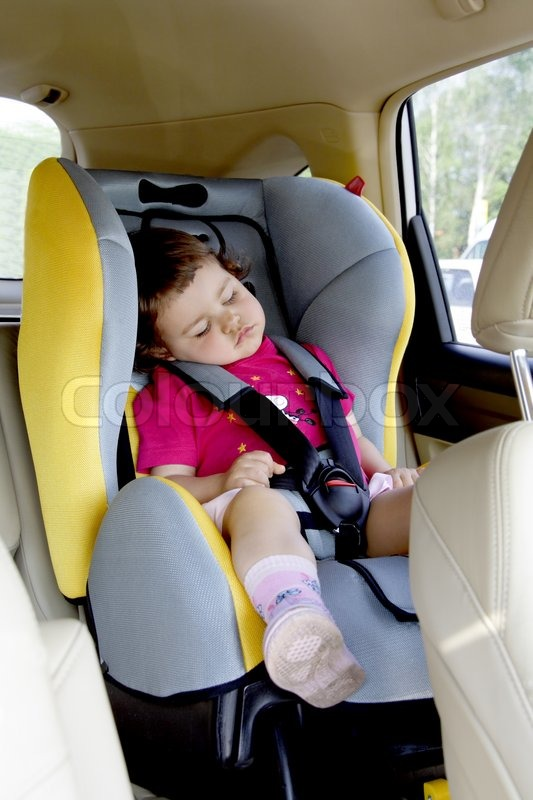 Baby Girl Quietly Sleeping In Car Seat
