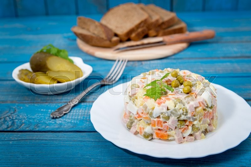 Stock image of 'Traditional Russian salad Olivier with fresh vegetables'