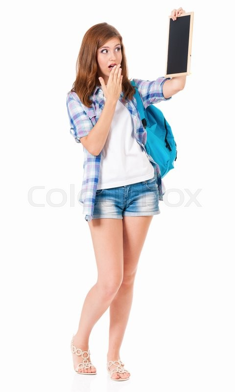 Stock image of 'Beautiful teen girl with small blackboard posing on white background'