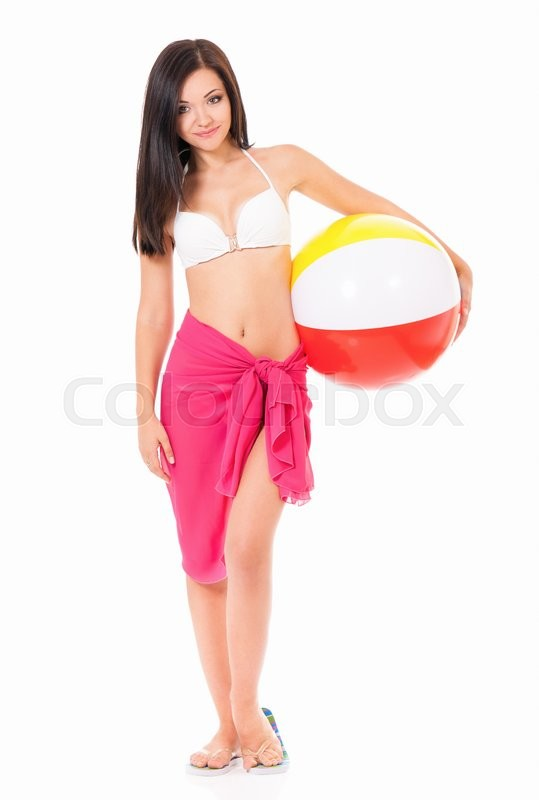 Stock image of 'Full length portrait of happy young woman in swimsuit with beach ball, isolated on white background'