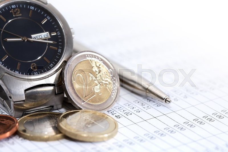 Stock image of 'Set of European coins near wristwatch and pen on paper with digits'