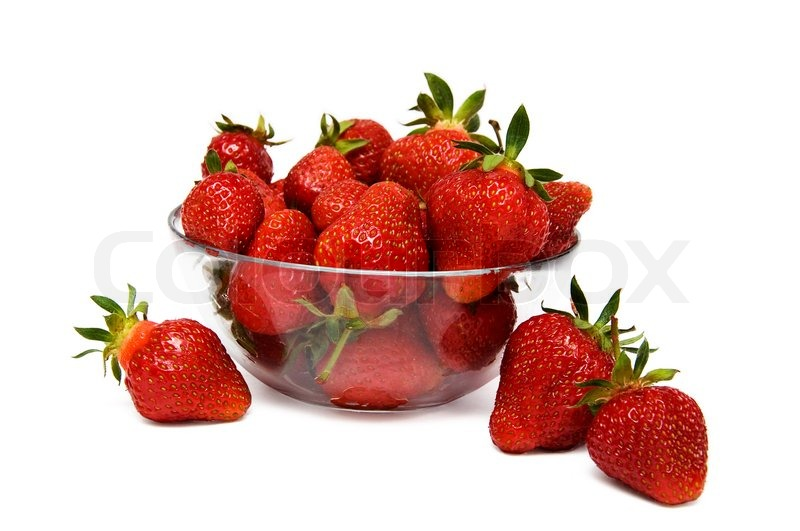 Stock image of 'Strawberries in a glass bowl isolated on a white background'