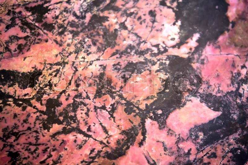 Stock image of 'Rhodonite mineral background'