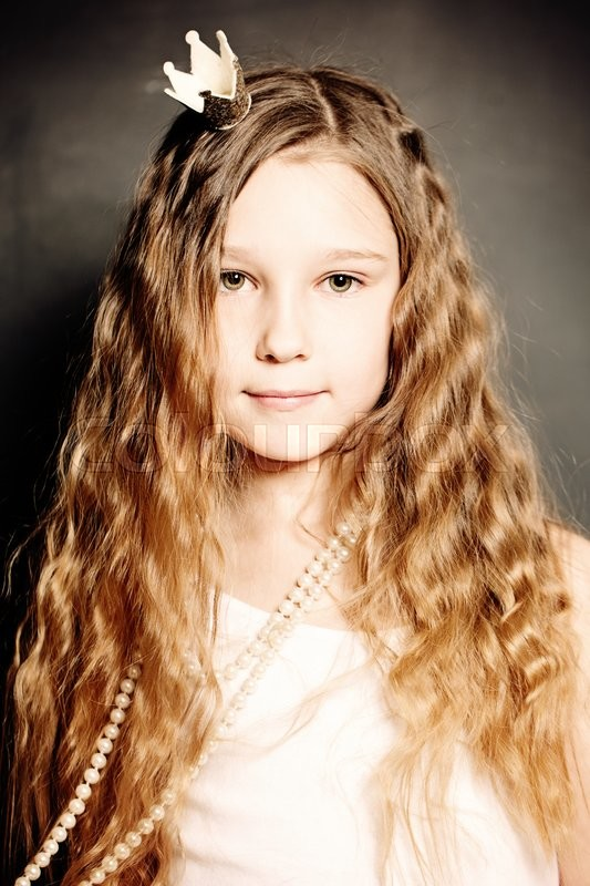 Stock image of 'Young Girl Fashion Portrait. Cute Face, Long Curly Hair, Princess Crown.'