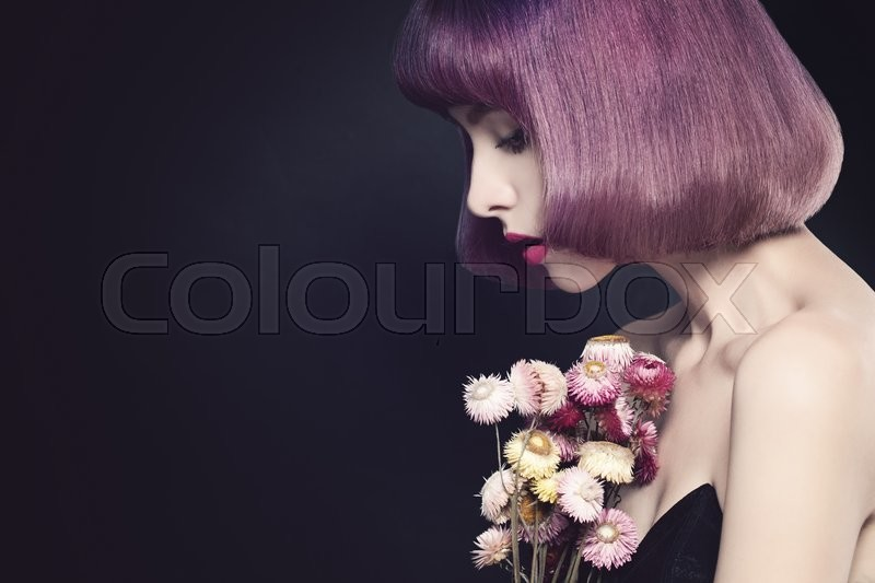 Stock image of 'Pretty Girl and Flowers on Background. Fashion Portrait'