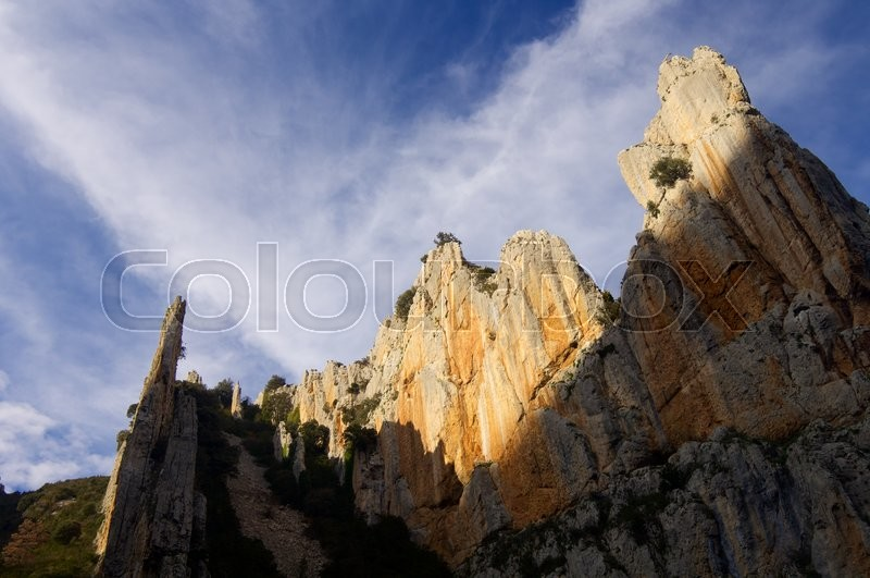 Stock image of 'rocky needles and cloudy sky in Spain.'