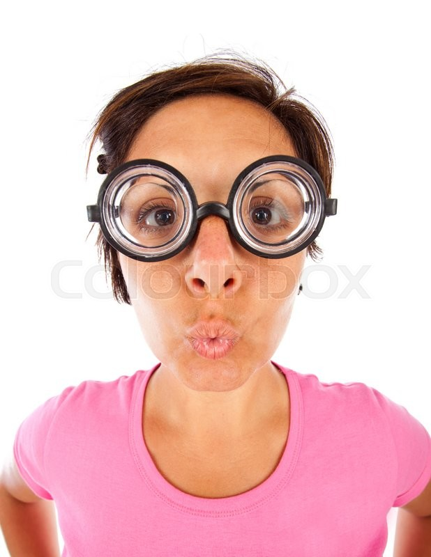 Stock image of 'Close up of a young woman with  thick glasses and surprised expression on white background'