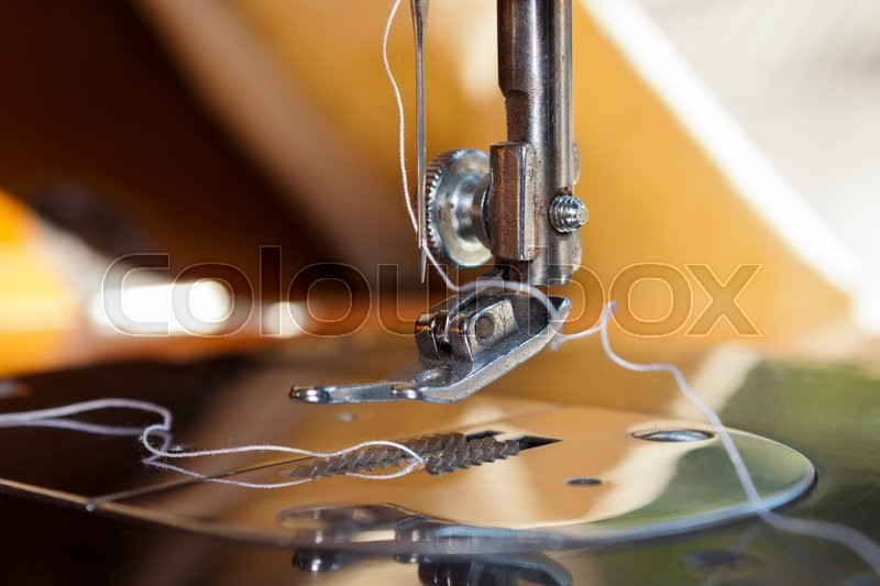 Stock image of 'Closeup of a sewing machine threading. Foot, needle and thread.'