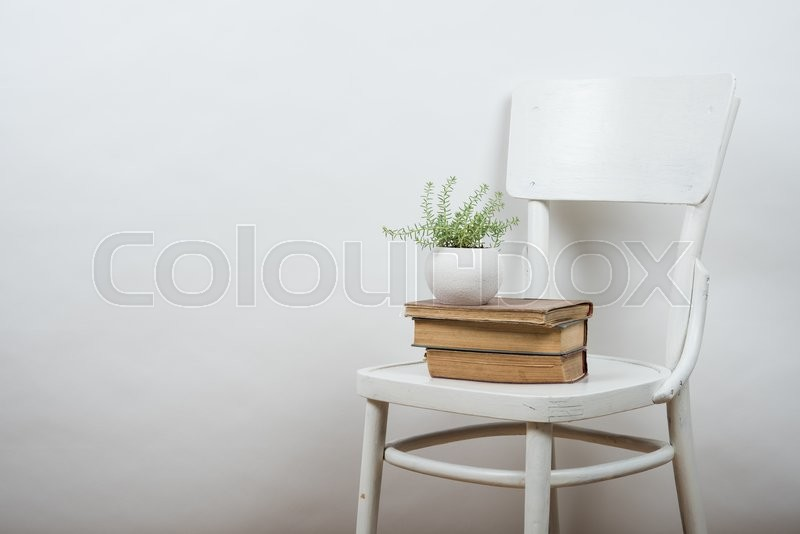 Stock image of 'White chair and empty wall background, room interior wall art poster mock up'