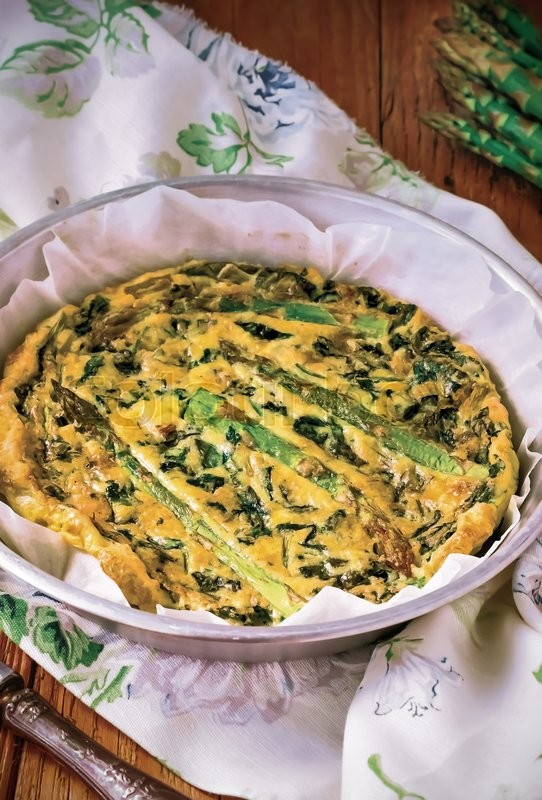 Stock image of 'Homemade Spring Vegetable Frittata, Italian Omelet, Italian Omelette(Frittata) with Asparagus and Spinach, prepared baking process'