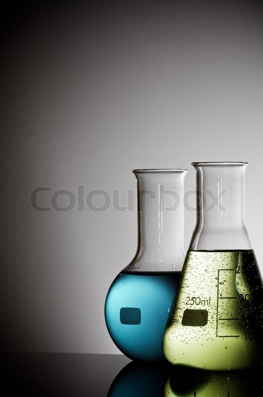 Stock image of 'group of laboratory flasks with liquid inside'
