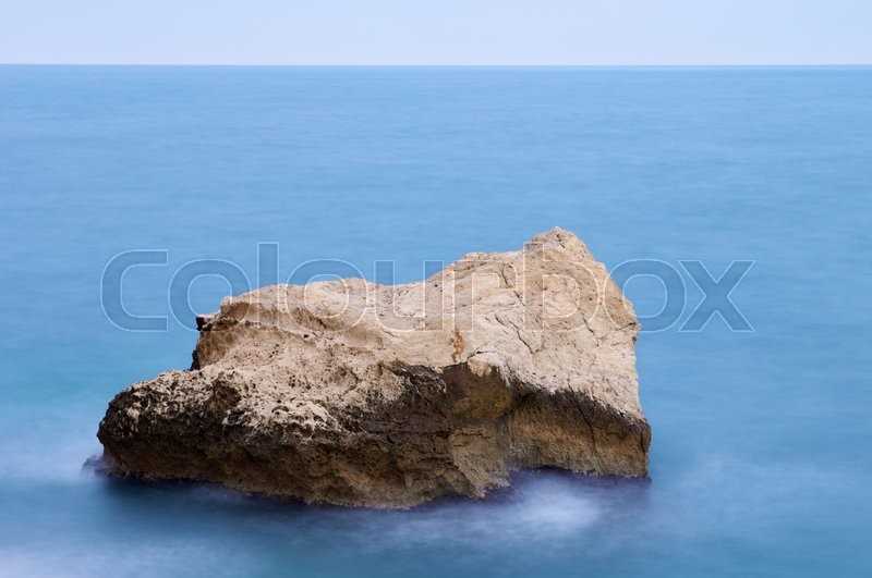 Stock image of 'Rocks in water at the shore in Calpe, Alicante, Valencia, Spain'