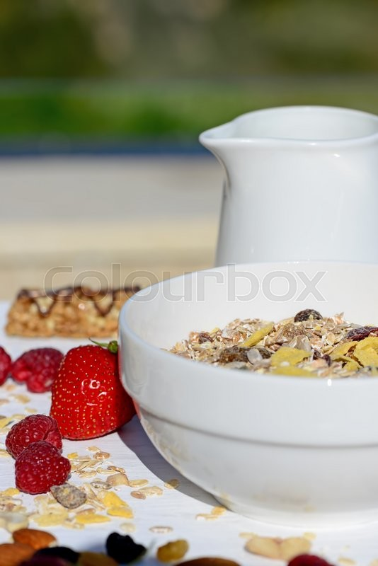 Stock image of 'Home-made breakfast muesli with milk'