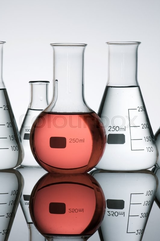 Stock image of 'group of laboratory flasks containing liquid color'