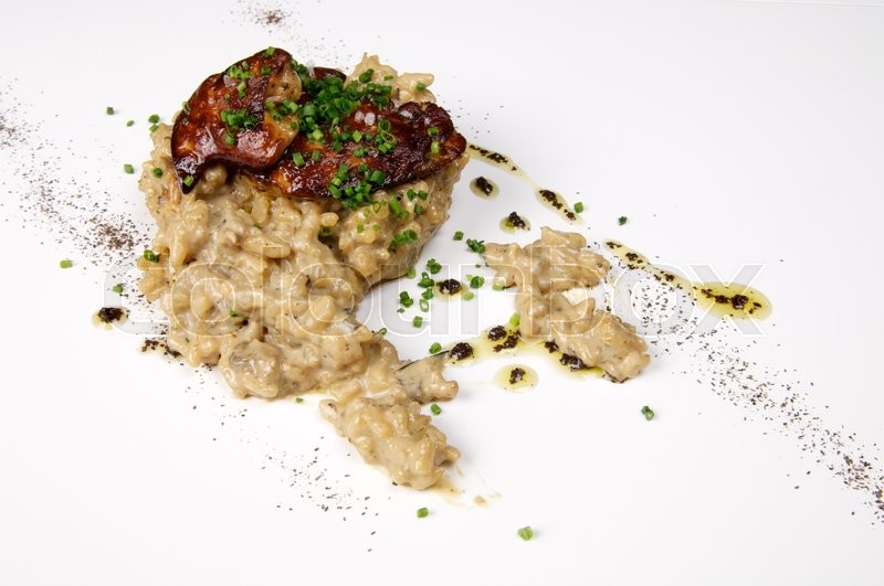 Stock image of 'Mushroom risotto, truffles and foie.'