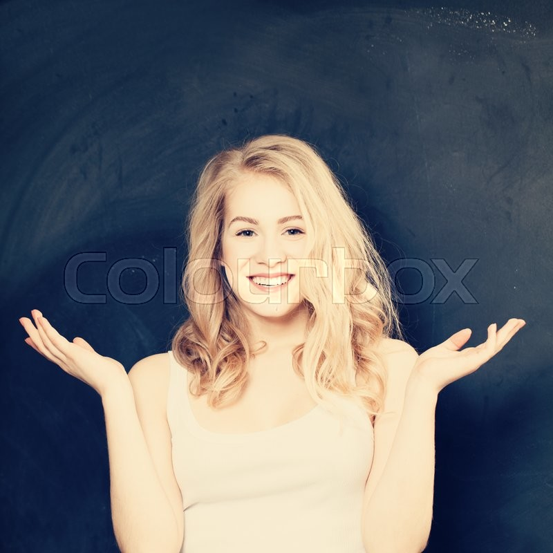 Stock image of 'Surprise. Surprised Girl having Fun on blue background'