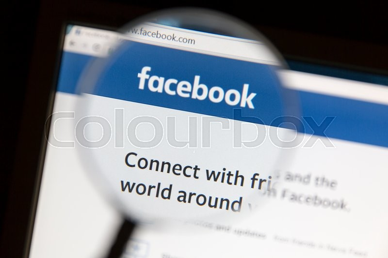 Editorial image of 'Ostersund, Sweden - May 22, 2016: Facebook website under a magnifying glass. Facebook is the most visited social network in the world'