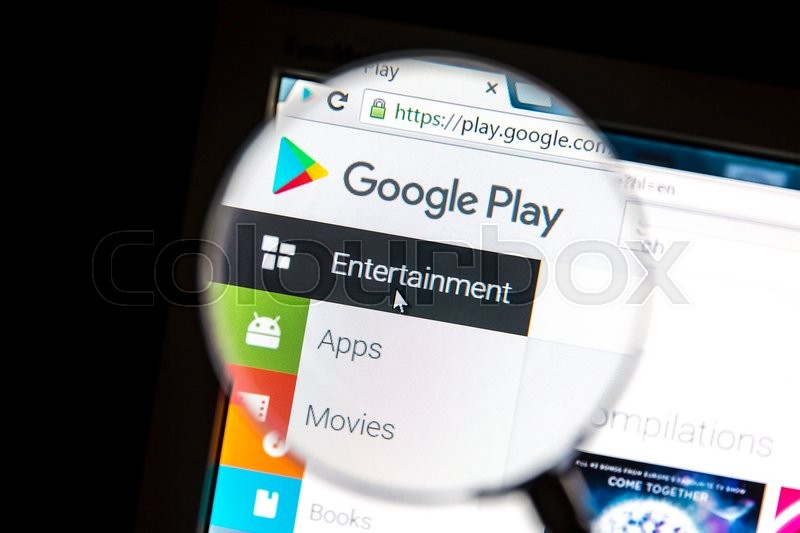 Editorial image of 'Ostersund, Sweden - May 20, 2016: Google Play's website under a magnifying glass Google Play is a digital distribution platform operated by Google.'