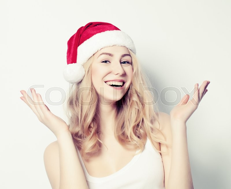 Stock image of 'Happy Christmas Woman in Santa Hat on White Background'