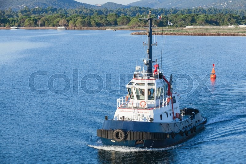 Editorial image of 'Corsica, France - July 2, 2015: Persevero tug 40T. Industrial boat with white superstructure and dark blue hull underway on sea water'