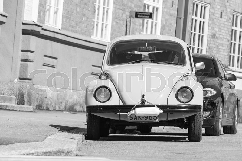 Editorial image of 'Helsinki, Finland - May 7, 2016: Old yellow Volkswagen beetle, front view, black and white'